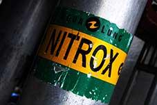 botella con la etiqueta de nitrox